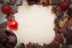 Blank paper surrounded by chocolate cookies. Christmas and New Year background. Blank sheet of paper for recipes or congratulations, surrounded by chocolate Royalty Free Stock Photo