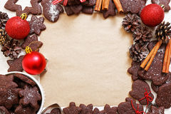 Blank paper surrounded by chocolate cookies. Christmas and New Year background. Blank sheet of paper for recipes or congratulations, surrounded by chocolate Stock Photography