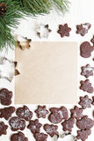 Blank paper surrounded by chocolate cookies. Blank sheet of paper for recipes or congratulations, surrounded by chocolate cookies Royalty Free Stock Image