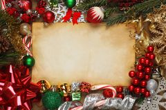 Blank paper surrounded by Christmas ornaments. Decorations, and tree branches Stock Image
