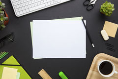 Blank Paper Surrounded By Office Equipment On Gray Desk Royalty Free Stock Photos