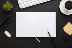 Blank Paper Surrounded By Office Supplies On Gray Desk Royalty Free Stock Image