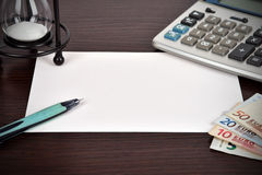 Blank paper on a table Royalty Free Stock Photo