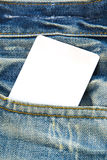 Blank paper tag price on blue jean.  Royalty Free Stock Photo