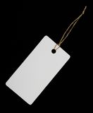 Blank paper tag. Blank tag tied with string isolated on black background Stock Photos