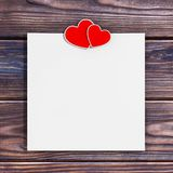 Blank Paper with Two Hearts. 3d Rendering. Blank Paper with Two Hearts on a wooden table. 3d Rendering Stock Image
