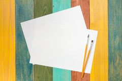 Blank paper and two paint brushes Stock Image