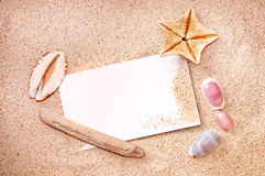 Blank paper on white beach sand Royalty Free Stock Image