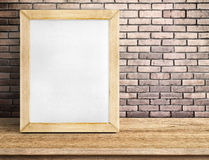 Blank paper white board on wooden table at red brick wall,Templa Royalty Free Stock Photography