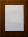 Blank Paper on Wood. Blank paper A4 on wood board background Royalty Free Stock Photos