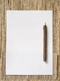 Blank Paper and wood Pencil on nature background. Top view Royalty Free Stock Image