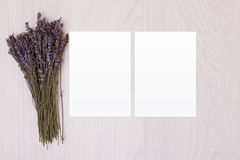 Blank paper on wood table with lavender. White paper. Postcard stock image