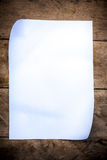 Blank paper on wood wall. White blank paper on wood wall background Stock Photo