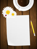 Blank paper on wooden background with flowers. Royalty Free Stock Images