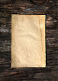 Blank Paper on Wooden Background Stock Image