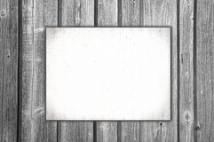 Blank paper on wooden wall Stock Photos