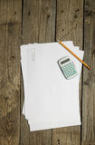 Blank papers, calculator and pencil Royalty Free Stock Images
