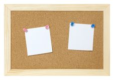 Blank papers on cork board Royalty Free Stock Image