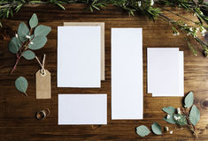 Blank Papers Laying on Marble Table With Leaves Decoration Royalty Free Stock Photography