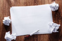 Blank Papers and Pen with Crumpled Papers on Sides Royalty Free Stock Photos
