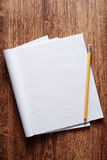 Blank Papers and Pen with Crumpled Papers on Sides Stock Images