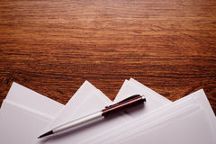 Blank Papers and Pen with Crumpled Papers on Sides Stock Photography