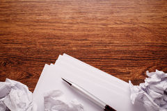 Blank Papers and Pen with Crumpled Papers on Sides Stock Photos