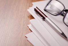 Blank Papers and Pen with Crumpled Papers on Sides Stock Image