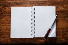Blank Papers and Pen with Crumpled Papers on Sides Royalty Free Stock Photography
