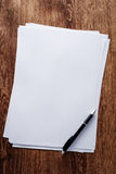 Blank Papers and Pen with Crumpled Papers on Sides Royalty Free Stock Image