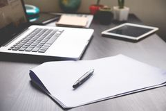Blank Papers with pen,tablet and laptop on the desk. Blank Papers with pen,tablet and laptop on   the desk. Office Life. Business Life Stock Photos
