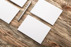 Blank papers, pencil on wooden table. Mock up blank papers table white render view design Stock Images