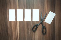 Blank papers and scissors on the wood background. Business concept Royalty Free Stock Photo