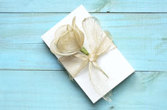 Blank papers to write letters. Tied with a raffia ribbon and decorated with an artificial flower on an old blue wooden table Stock Photography