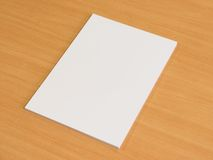 Blank papers on wooden office table Royalty Free Stock Photography