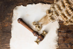 Judge's wig and blank text. Blank parchment with judge's wig and gavel stock photos