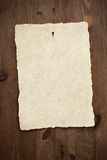 Blank parchment paper on old door. Stock Photo