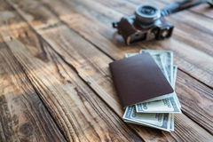 Blank passport and camera with US dollars Royalty Free Stock Images