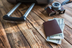 Blank passport and camera with US dollars Stock Photo