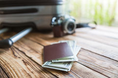 Blank passport and camera with US dollars Royalty Free Stock Photo