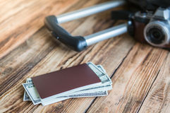 Blank passport and camera with US dollars Royalty Free Stock Image