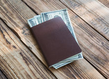 Blank passport with US dollars Royalty Free Stock Image