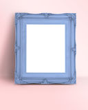 Blank pastel blue Vintage Victorian style picture frame on paste Royalty Free Stock Image