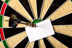 Blank peace of paper on dartboard Stock Photos