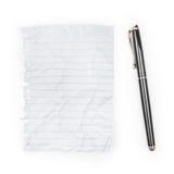 blank penna för anmärkningspapper Arkivfoto