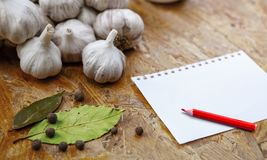 Blank with pensil with garlic stock images