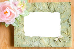 Blank phot frame and pink rose flower Stock Images