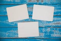 Blank photo frame album on blue wood background Stock Image
