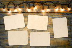 Blank photo frame album. Empty old instant photos paper on wood table in christmas. vintage and retro style royalty free stock photos