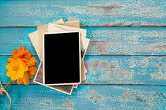 Blank photo frame album with flower on  blue wood background Royalty Free Stock Image